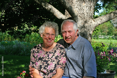 an elderly couple, in their backyard.
