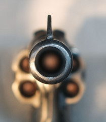loaded revolver aimed at the viewer