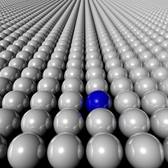 one blue ball amongst many white balls