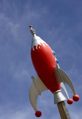rocket against blue sky