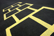 hopscotch game yellow on pavement