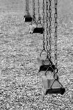 playground swings in black and white poster