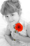 beautiful four year old girl holding orange daisy poster