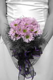 bride holding bouquet with picture in black and white but flower poster