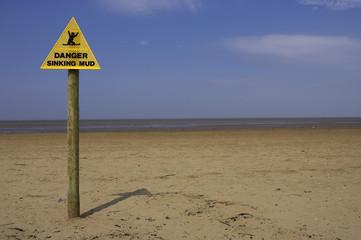 danger sinking mud sign