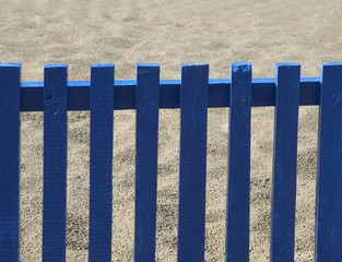 blue fence and sand