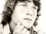 close up of sixteen year old teen boy in sepia poster