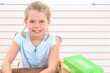 school girl in desk against writing line backgroun poster