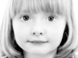 close up of 4 year old girl in black and white poster