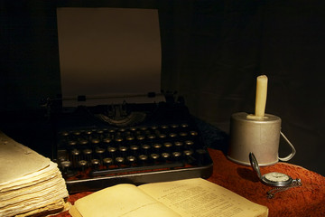 old book, rare typewriter and watch