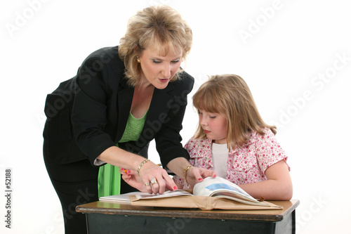 teacher helping student one on one