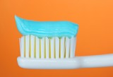 toothbrush with toothpaste poster