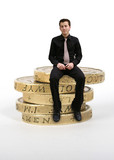 business man sitting on coins poster