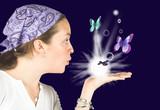 beautiful girl blowing butterflies - mind reader poster