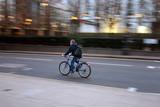 commuter on bike 2 poster