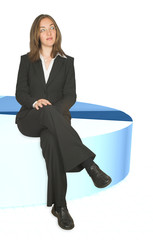 business woman sitting on pie chart closeup