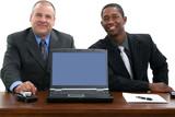 businessmen at desk with laptop poster
