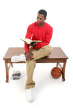 casual man sitting on table reading book poster
