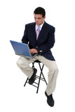 business man on stool with laptop poster