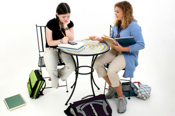 tween girls doing homework after school