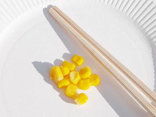 corn and chopsticks