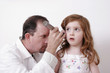 doctor examining a child's ear