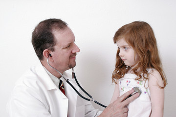 doctor listening to a child's heart
