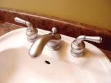 bathroom sink and taps poster