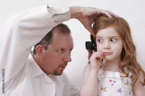 doctor looking in little girl's ear