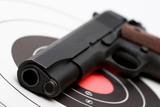 gun over bullseye poster