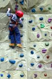 boy climbing a wall poster