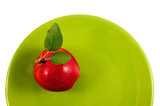 red apple on a green plate poster