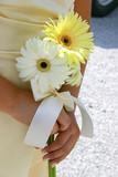 bridal attendant holding flowers poster