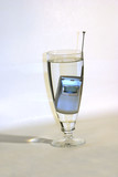 cell phone in glass of water poster