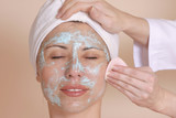 therapist removing moisture mask poster