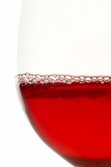 wine glass filled with red wine  with bubbles study