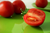 tomatoes on a green plate poster