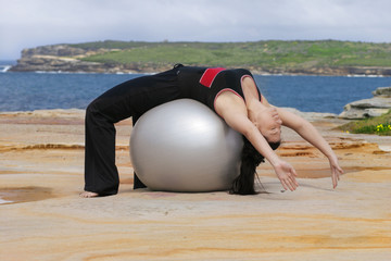 pilates - ball stretch backwards