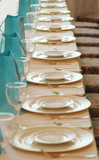 glasses and plates in a row poster