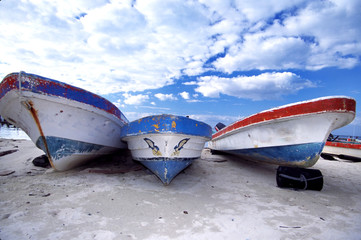 boats on beach and beautiful sky with clouds mexic