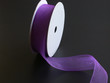 purple ribbon on a black background