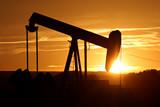 oil pump against setting sun poster