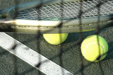 racquet and balls through the net poster