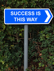 success is this way sign