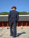 elderly man in suit poster