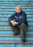 man sitting on steps poster