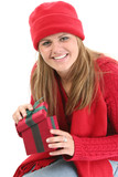 young woman in red winter clothes with gift box poster