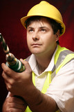 tradesmen with a drill poster