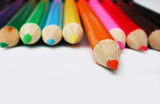 orange pencil crayon isolated from other colorful poster
