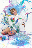 beautiful young woman covered in paint poster